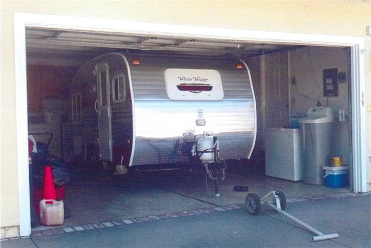 Starling travel riverside retro travel trailers brand for Rv trailer with garage